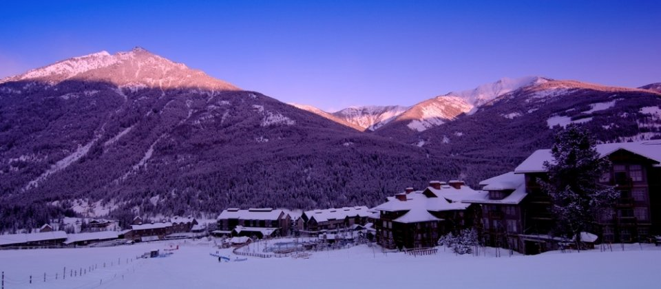 View of the village and mountains at sunrise at Panorama Mountain Village near Invermere - Destination BC / David Gluns